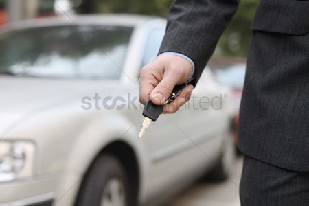 Car : Businessman with car key