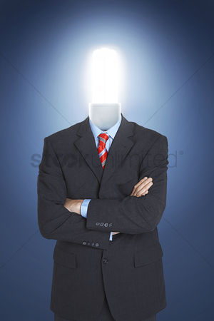Proud : Businessman with economical friendly light bulb for head