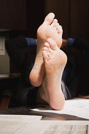 Interior : Businessman with feet up on desk