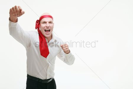 Celebrating : Businessman with red tie tied around his head celebrating his success