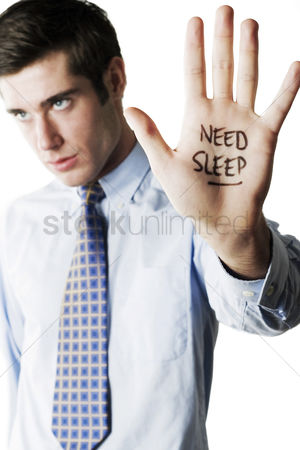 Supervisor : Businessman with the word  need sleep  written on his palm