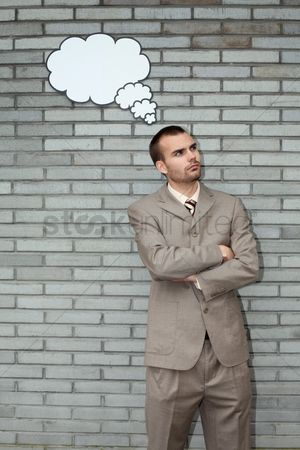 Cardboard cutout : Businessman with thought bubble