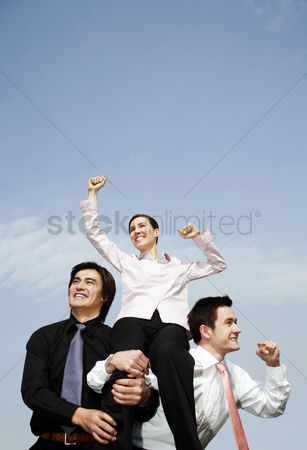 Lively : Businessmen lifting up the female winner