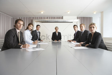 Businesswomen : Businesspeople at conference table