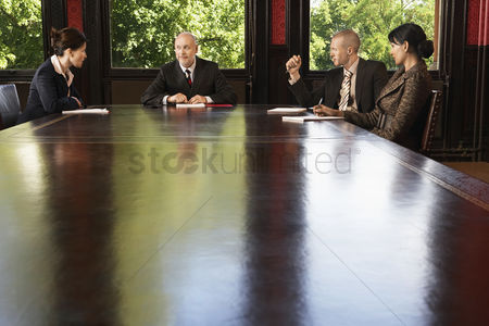 Maturity : Businesspeople meeting around boardroom table