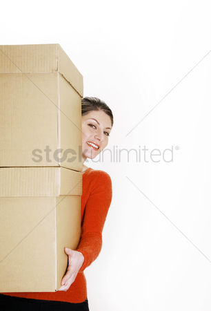 Strong : Businesswoman carrying a stack of boxes