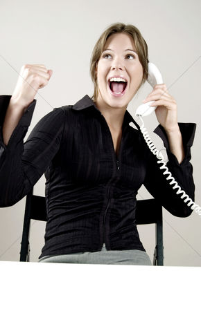 Celebrating : Businesswoman celebrating while talking on the phone