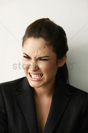 Rage : Businesswoman clenching her teeth
