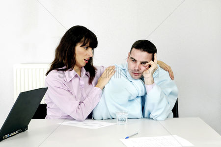 Employee : Businesswoman consoling her depressed colleague