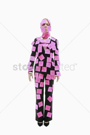Frowning : Businesswoman covered with adhesive notes looking sad