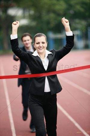 Eastern european ethnicity : Businesswoman crossing the finishing line