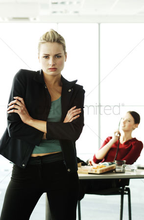 Ignorance : Businesswoman getting frustrated with her colleague
