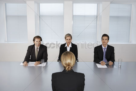 Business suit : Businesswoman giving presentation to executive team