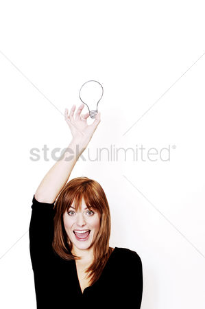 Thought : Businesswoman holding a light bulb