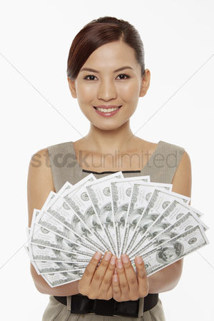 China : Businesswoman holding a pile of cash
