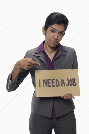 Unemployment : Businesswoman holding  i need a job  sign