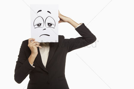 Business suit : Businesswoman holding up a sad face doodle