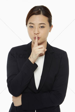 Instruction : Businesswoman holding up her index finger