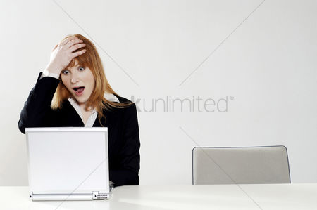Lady : Businesswoman in shock while using laptop