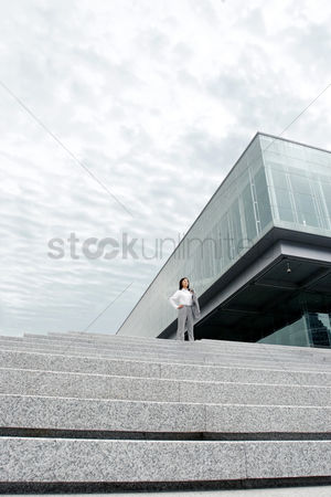 Steps : Businesswoman posing on the stairs