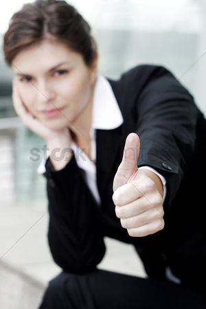 Determined : Businesswoman showing a thumb up