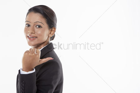 Malaysian indian : Businesswoman showing hand gesture