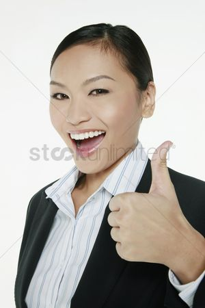 Finger : Businesswoman showing thumbs up