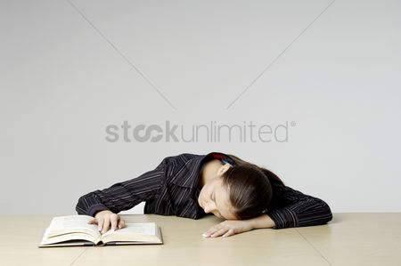 Educational : Businesswoman sleeping with her head on the table