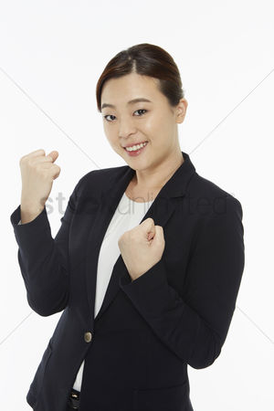 Excited : Businesswoman smiling and cheering