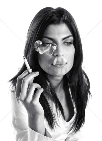 Thought : Businesswoman smoking cigarette