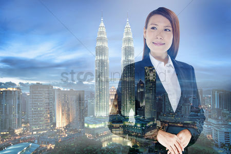 Business suit : Businesswoman standing against a cityscape background