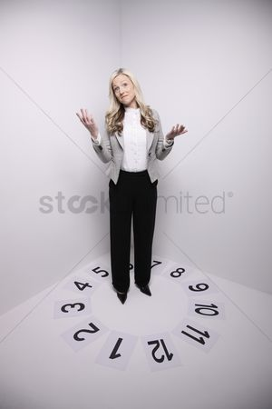 Ignorance : Businesswoman standing in a circle of numbers  making a face