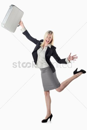 British ethnicity : Businesswoman swinging her bag happily