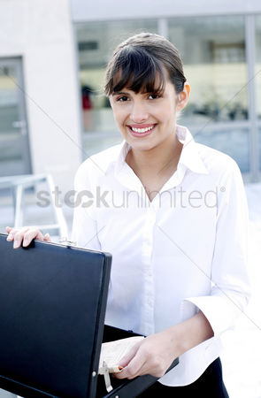 Determined : Businesswoman taking out documents from the briefcase