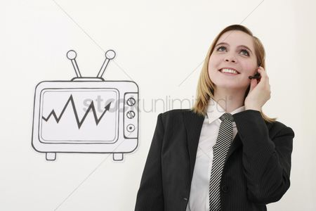 Cardboard cutout : Businesswoman talking on headset beside television
