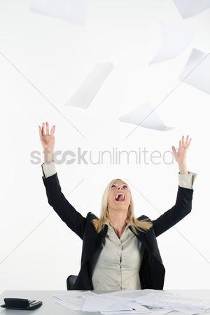 British ethnicity : Businesswoman throwing papers in the air