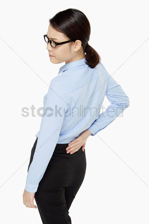 Pain : Businesswoman touching her lower back