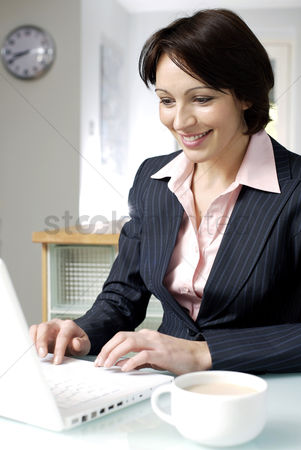 Food  beverage : Businesswoman using laptop