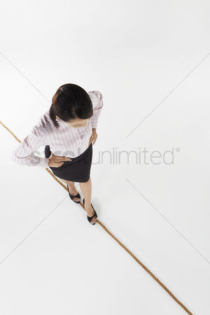 Careful : Businesswoman walking on a tightrope