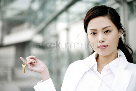 Transportation : Businesswoman with a key hanging on her finger