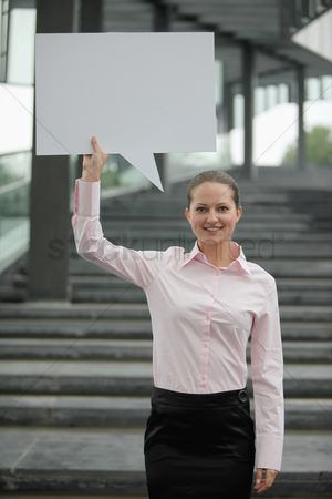 Cardboard cutout : Businesswoman with a speech bubble