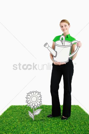 Cardboard cutout : Businesswoman with a watering can