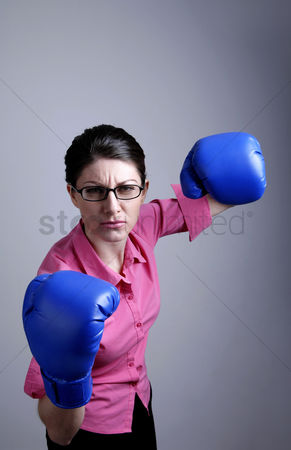 Strong : Businesswoman with blue boxing gloves