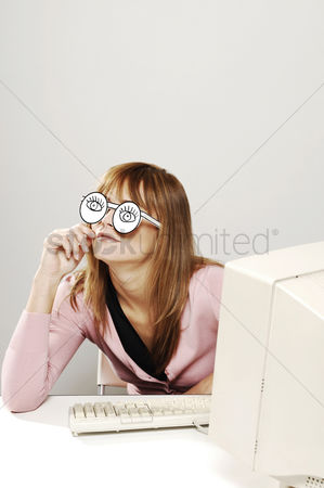 Cardboard cutout : Businesswoman with cardboard cut out spectacles thinking