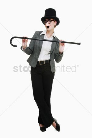Dance : Businesswoman with funny disguise and dance cane