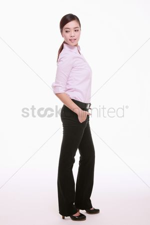 Pocket : Businesswoman with hand in the pocket and looking to the side
