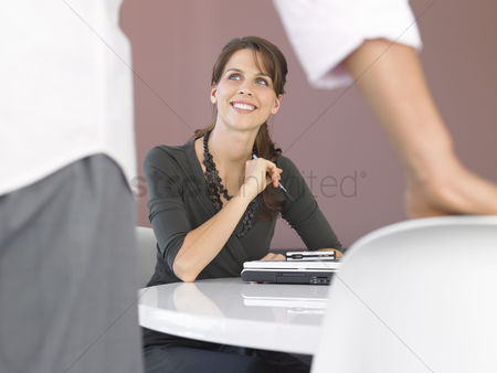 Interior background : Businesswoman with laptop at table