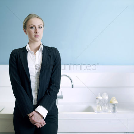 Composed : Businesswoman with milk bottles on the sink