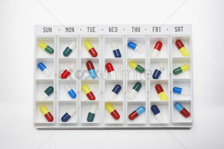 Medication : Capsule pills in container with days