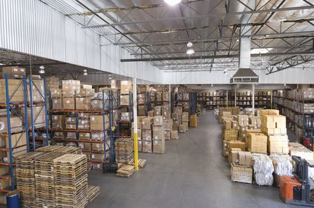 No people : Cardboard boxes stacked in distribution warehouse
